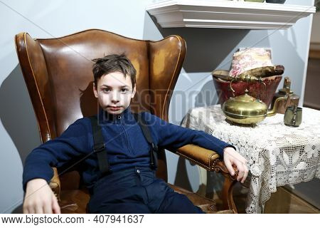 Child Sitting In Vintage English Leather Chair