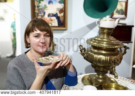 Woman Drinking Tea From Samovar In Cafe