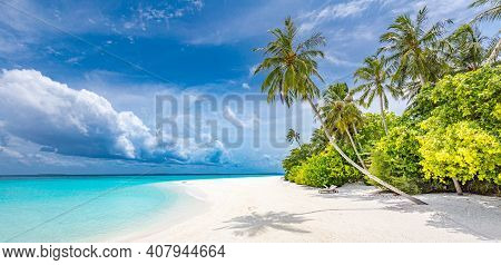 Beautiful Tropical Beach With White Sand, Palm Trees, Turquoise Ocean Against Blue Sky With Clouds O