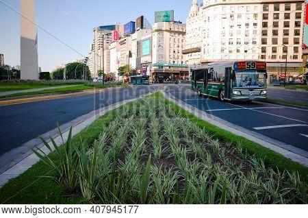 Buenos Aires, Argentina - January, 2020: Bus Route 59 Driving Near Obelisco De Buenos Aires - Obelis