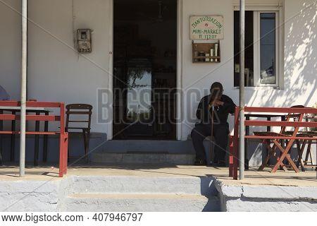 Sianna, Rhodes / Greece - June 23, 2014: A Man At Sianna Traditional Bar, Rhodes, Dodecanese Islands
