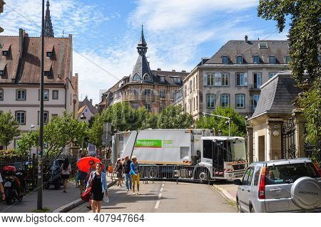 Strasbourg, France - July 29, 2017: Mercedes-benz And Large Crowd Of People Walking On The Street Of
