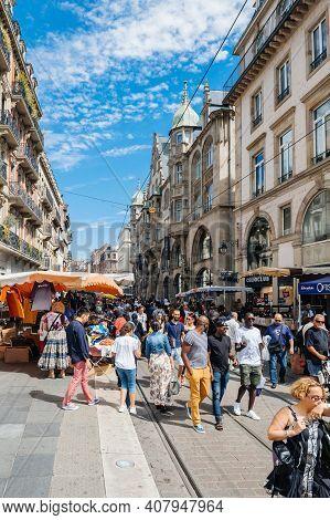Strasbourg, France - July 29, 2017: Large Crowd Of People Walking On The Tramway Line Street Strasbo