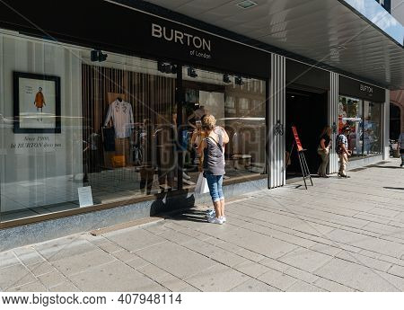Strasbourg, France - July 29, 2017: Female Customer In Front Of The Showcase Of Burton Of London Mal