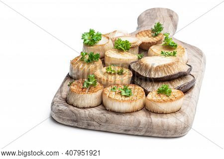 King  Oyster Mushroom Scallops On Wooden Board Isolated On White