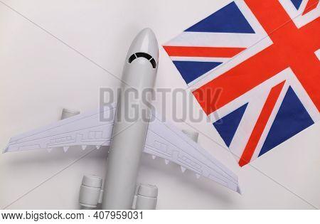 Travel Concept. Passenger Plane And British Flag On White Background