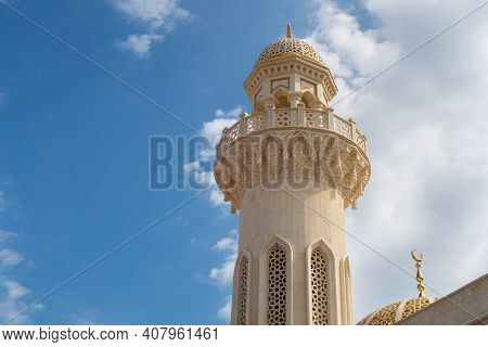 Ali Musa Mosque Marble And Sandstone Minaret Against Blue Sky, Old Muscat, Oman.