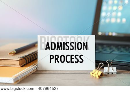 Admission Process - An Inscription On A Card Near Office Supplies And Computer