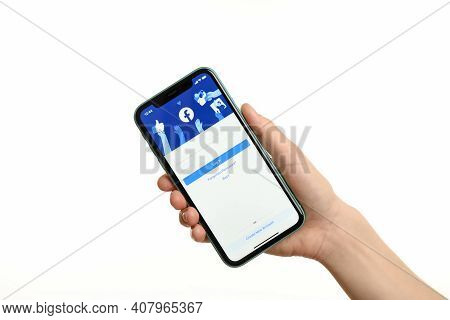 Mykolaiv, Ukraine - July 9, 2020: Woman Holding  Iphone X With Facebook App On White Background, Clo