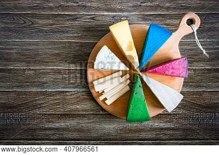 Assortment Of Different Sorts Craft Cheese. Cheeseboard On A Rustic Wooden Background With Copy Spac