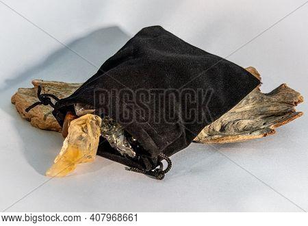 A Citrine Crystal Gemstone With A Black Velvet Gemstone Bag.