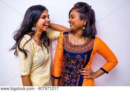Casual Indian Clothes , Two Indian Woman In Kurta Posing Over White Wall