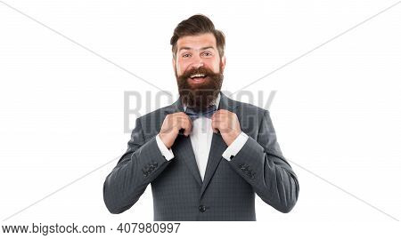 Man In Elegant Custom Tailored Expensive Suit. Happy Man In Suit Fixing Tie. Successful Man Smiling.
