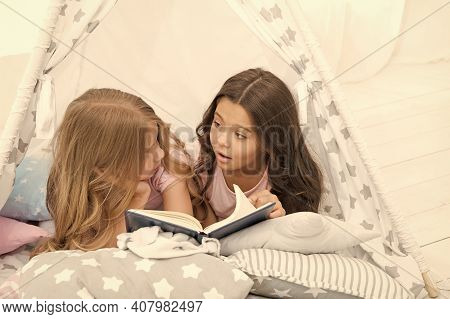 Imagination Ran Away With Them. Little Girls Read And Imagine During Bedtime. Cute Dreamers With Boo