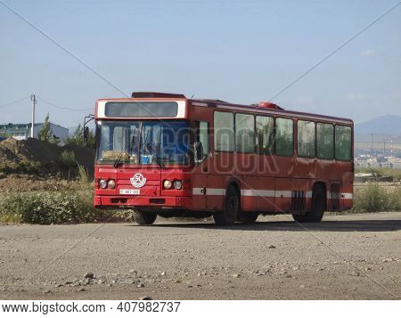 Kazakhstan, Ust-kamenogorsk, July 23, 2020: Scania Cn112cl. Red Old Bus On One Of The City Streets.