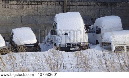 Kazakhstan, Ust-kamenogorsk, January 24; 2020: Row Of Old Broken Cars Under The Snow