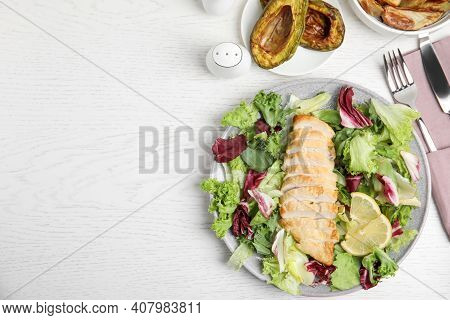 Tasty Cooked Chicken Fillet With Fresh Salad  And Space For Text On White Wooden Table, Flat Lay. He