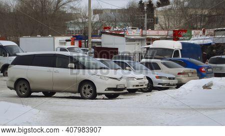 Kazakhstan, Ust-kamenogorsk, February 6, 2020: Cars Parked In The Parking Lot. Grunge Landscape. Urb