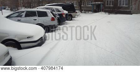 Kazakhstan, Ust-kamenogorsk, February 7, 2020: Cars Parked In The Parking Lot. Grunge Landscape. Res
