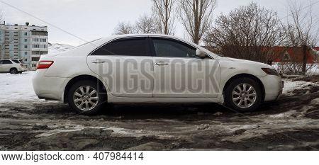 Kazakhstan, Ust-kamenogorsk, February 8, 2020: Toyota Camry Xv40. White Japanese Car. Winter Snow