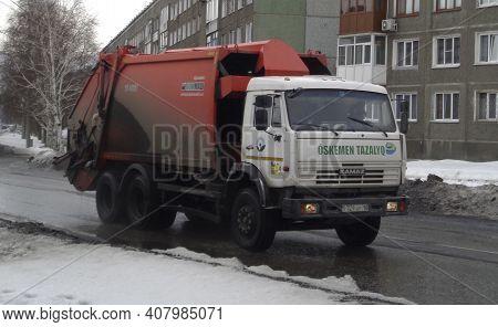 Kazakhstan, Ust-kamenogorsk, March 3, 2020: Kamaz Garbage Truck At The City Street