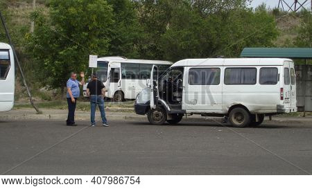 Kazakhstan, Ust-kamenogorsk, May 21, 2020: Mini Buses At The Bus Stop. Terminal Bus Stop. Public Tra