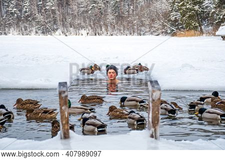 Vilnius, Lithuania - February 11 2021: Beautiful Boy Bathing And Swimming In The Cold Water Of A Lak