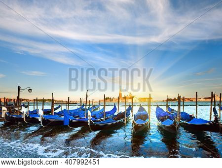 Parked Gondolas On Piazza San Marco And The Doge Palace Embankment And Sunset Sunshine (venice, Ital
