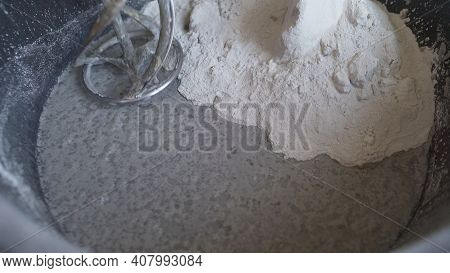 Mixing Construction Filler In A Bucket. Mixing Of A Plaster. Worker Mixing Plaster In A Bucket For A