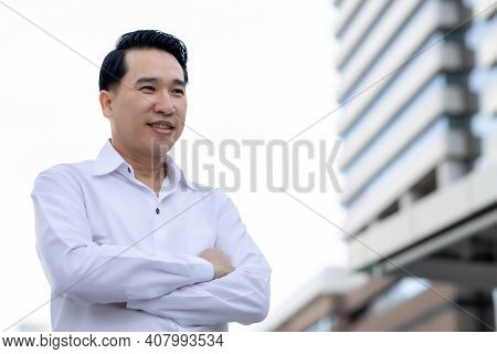 Portrait Asian Adult Man Looks To Copy Space With Arm Crossed Confident Business Man In White Shirt