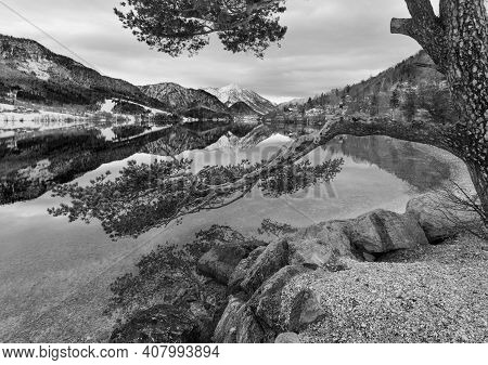 Grayscale. Cloudy Winter Alpine  Lake Grundlsee View (austria) With Fantastic Pattern-reflection On