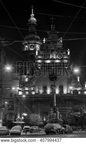 Grayscale. Night Winter Lviv City (ukraine) Cityscape. Bernardine Church And Monastery (church Of St