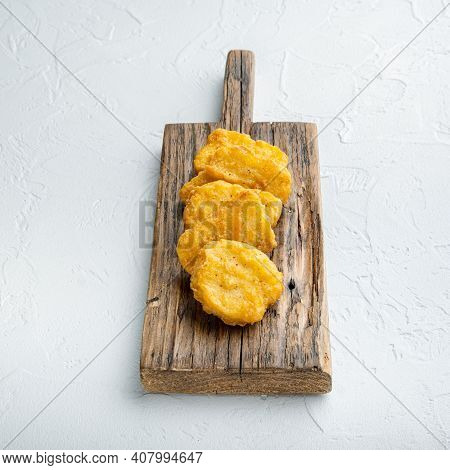 Nuggets Breaded On White Backgroundbreaded Nuggets On A Wooden Board