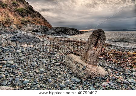 Stone Monument On Rocky Beach