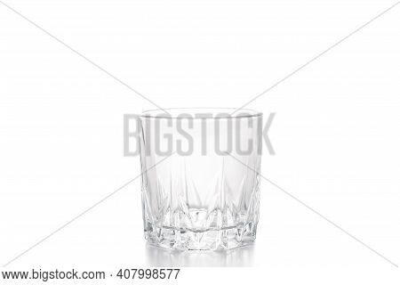 Empty Whiskey Glass. Transparent Glass Old-fashion Glass Isolated On A White Background.