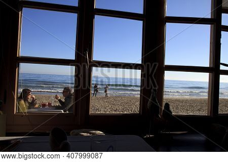 Alassio (sv), Italy - February 15, 2017: The Alassio Beach View From A Restaurant Window, Riviera De