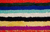 rug handmade knitted from strips of fabric colored. poster