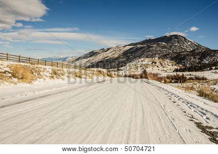 Snow-covered Backroad In Montana