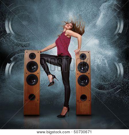 Woman Dancing Against Of Powerful Speakers