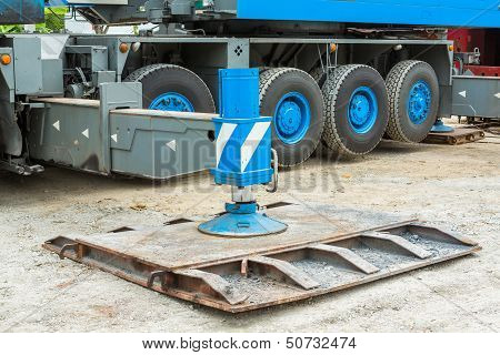 Heavy duty steel crane outrigger pad in construction site poster