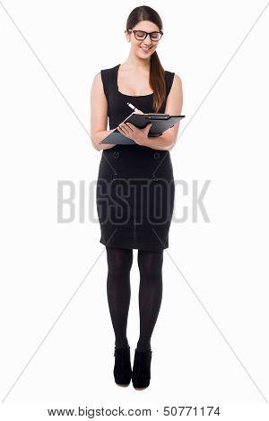 Pretty Secretary Taking Down Notes