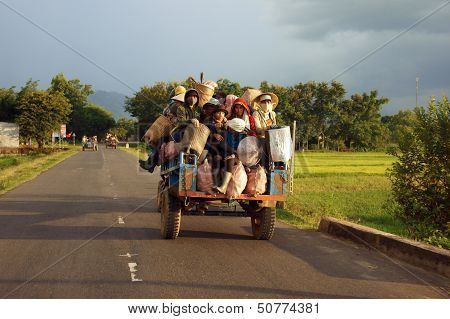 Ethinic minority move by  Cong Nong on road under golden light