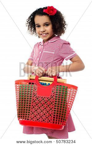 Pretty Child Carrying Math Equipment's In Basket