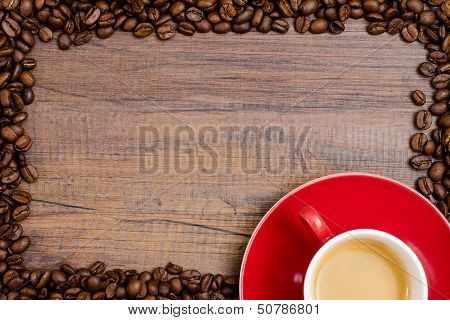Cup Of Espresso Coffee With Frame Of Beans