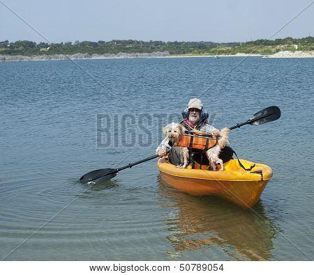 Senior And Dog Kayaking
