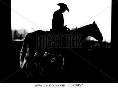 Silhouette of Cowboy Riding a Horse