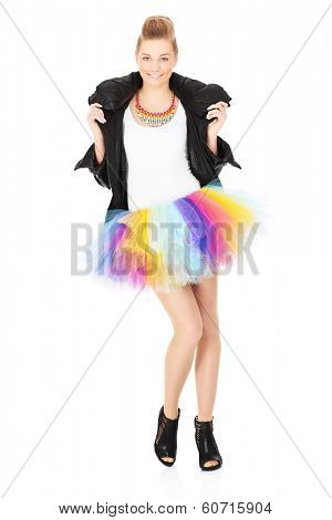 A picture of a young woman posing in a ballet skirt over white background