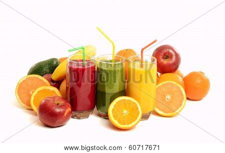 Pile of fruits and three glasses of fresh smoothie.
