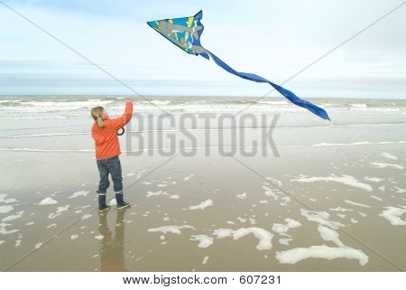 Flying Her Kite At The Beach
