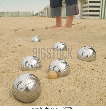 Playing A Ball Game At The Beach